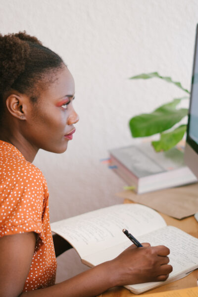 Photo of woman looking on computer
